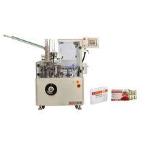 Estuchadora de carga superior / para la industria alimentaria / para blísters / intermitente