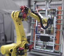 Célula robotizada de ensamblaje / para cristales