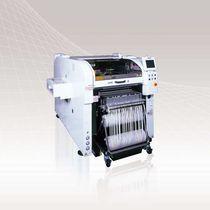 Máquina de inserción para componentes electrónicos