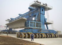 Carretilla elevadora de tipo straddle (horcaja) sobre neumáticos / para vigas prefabricadas de hormigón