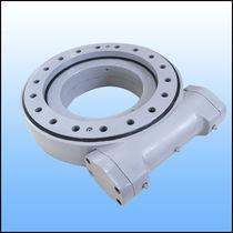 Sistema de arrastre giratorio para seguidor solar / con corona giratoria / de husillo sin fin / estanco al polvo