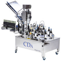 Etiquetadora automática / para etiquetas autoadhesivas / para aplicación en el lateral del producto / para botellas