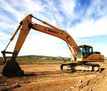 Excavadora intermedia / con orugas / para obra / para minas y canteras