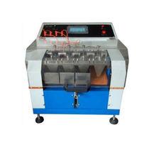 Máquina de ensayo de estanqueidad / para el cuero