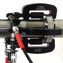 Sistema de fijación hidráulico / para tubos