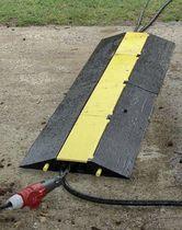 Protector para cable para suelo