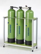 Unidad de purificación de agua con intercambiador de iones