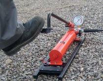 Bomba con pedal / de acero / de transporte
