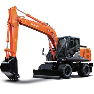excavadora intermedia / con neumáticos / para obra de construcción