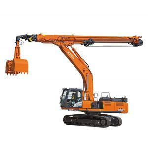 excavadora de brazo telescópico / de grandes dimensiones / con orugas / para obra de construcción