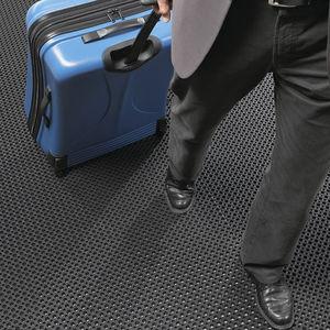 alfombra no absorbente / de caucho / modular / para zona de tráfico intenso
