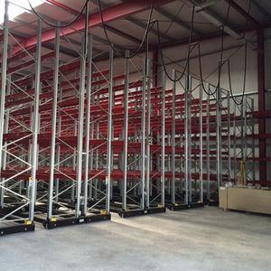 sistema de estanterías con paleta / para cargas pesadas / para carga mediana / móvil