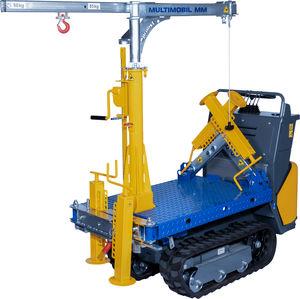 máquina colocadora de losetas con orugas